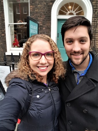 My husband and I smiling in front of the Dickens Museum.