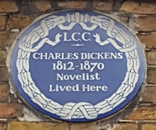 Plaque lists years of Dickens' life, not his time here. He lived here 1837-1839.