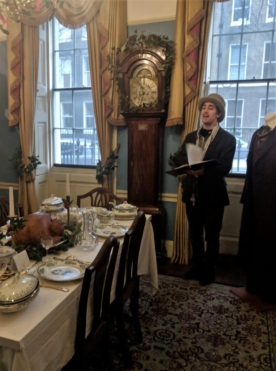 Dickens' descendant Oliver performing a reading.